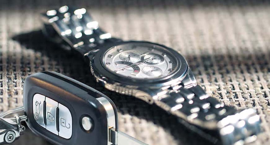 A key fob and a watch. At Interstate All Battery Center Las Vegas, we offer key fob and watch battery replacement